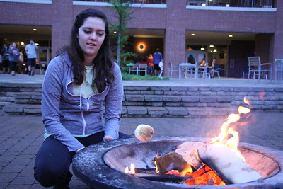 Meredith Comer roasts her marshmallow.