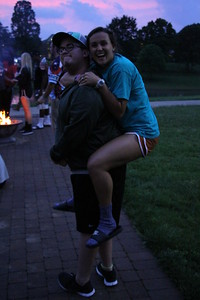 Erick Hooker gives Merideth Byl a piggy back ride.
