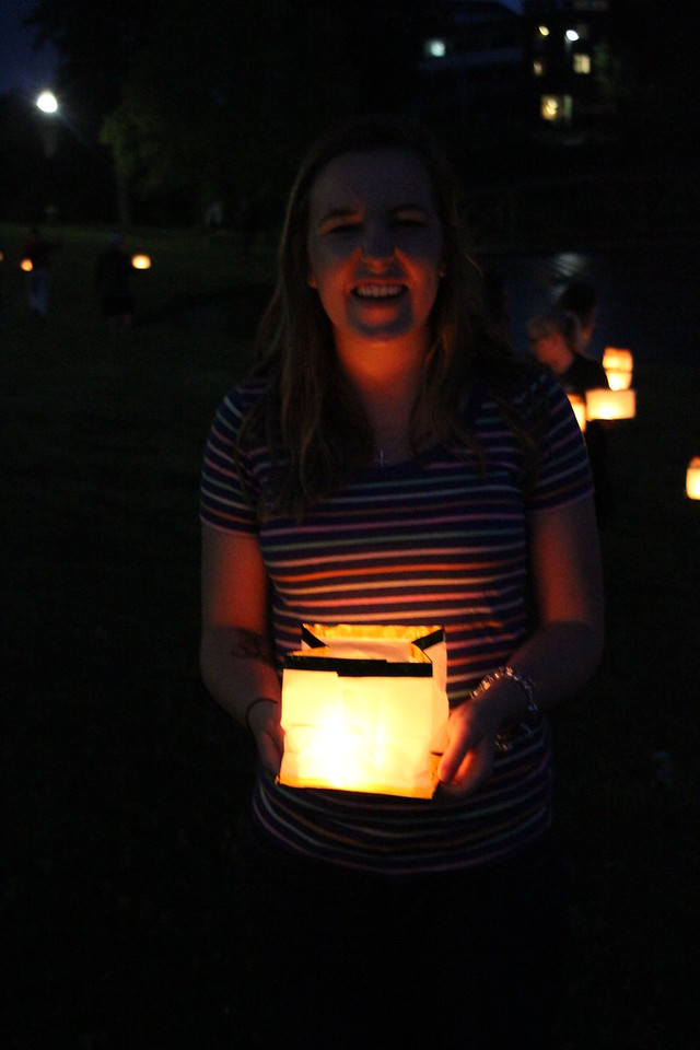 Senior class president Caitlyn Brotherton poses with her lantern on the way to the lake.