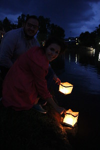 Tori James and Jacob Kirby let their lanterns go on the lake.