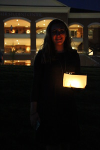 Emily DeVries poses with her lantern on the way to the lake.