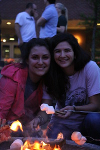 Tori James and Mary Toohey hang out by the fire.