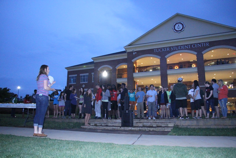 Seniors gathered to hear Caitlyn Brotherton, the senior class president, say a few words before they released their lanterns.