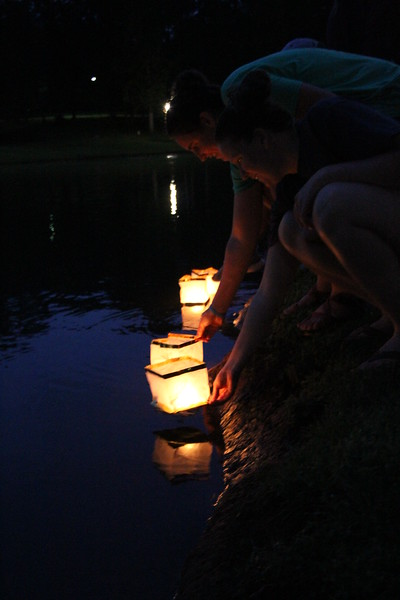 Taylor Schwartz and Giorgie Graves release their lanterns on the lake.