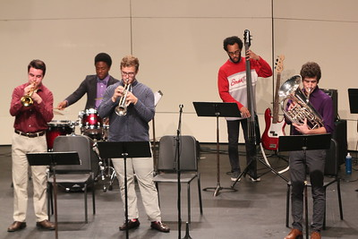 Robbie Collins, Mike Terry, Michael Brotherton, Omar Wingo, and Matthew Pennell rocking out