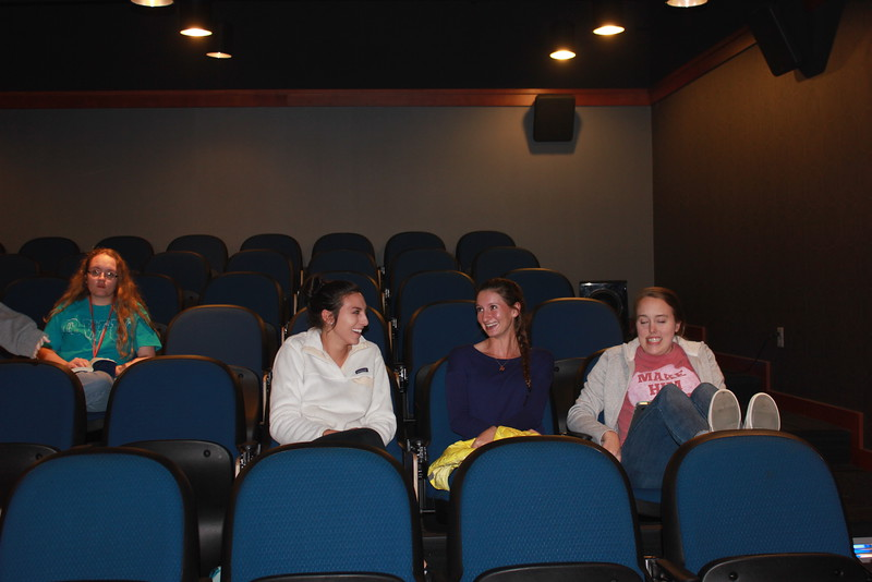 Students chat before the movie begins