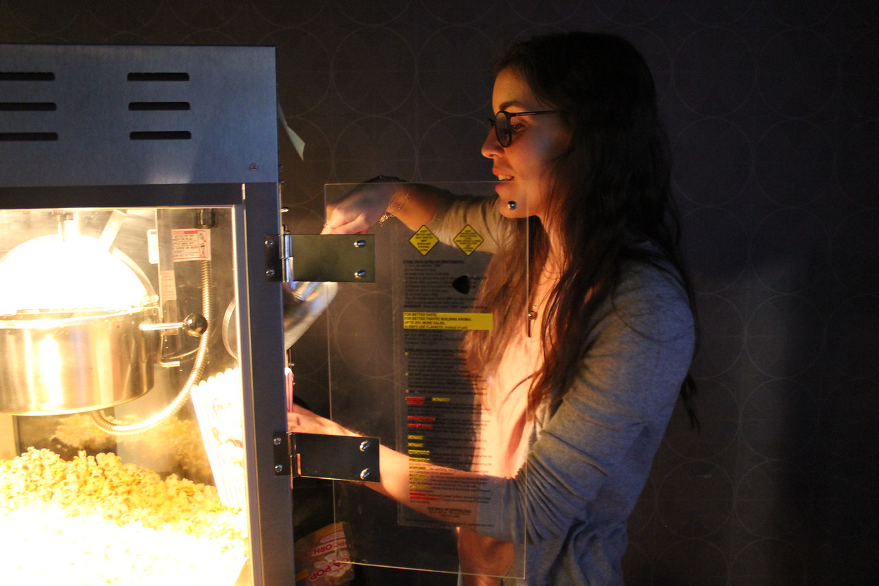 Spanish TA prepares popcorn for students