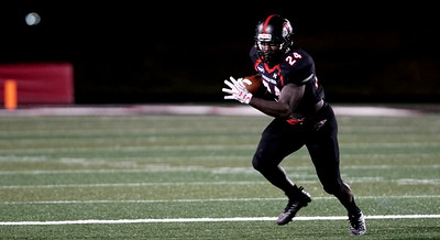 Khalil Lewis runs with the ball. -Taken by Ashley Falls