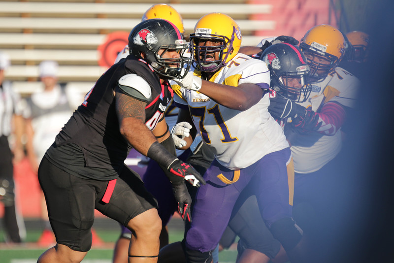 GWU football player goes head-to-head with a Benedict player.