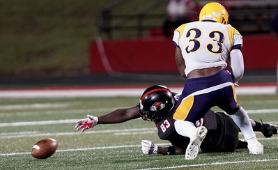 Mike Estes looses the ball after being tackled. -Taken by Ashley Falls