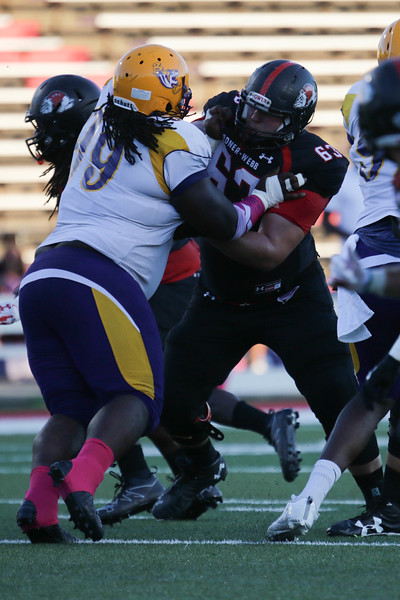#63, Caleb Smith, attempts to take down Benedict #19.