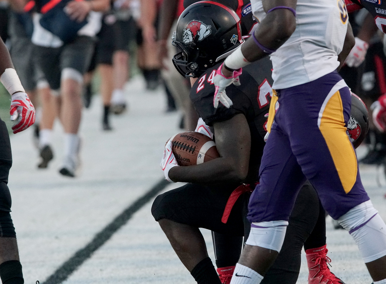 Khalil Lewis squats at the sidelines. -Taken by Ashley Falls