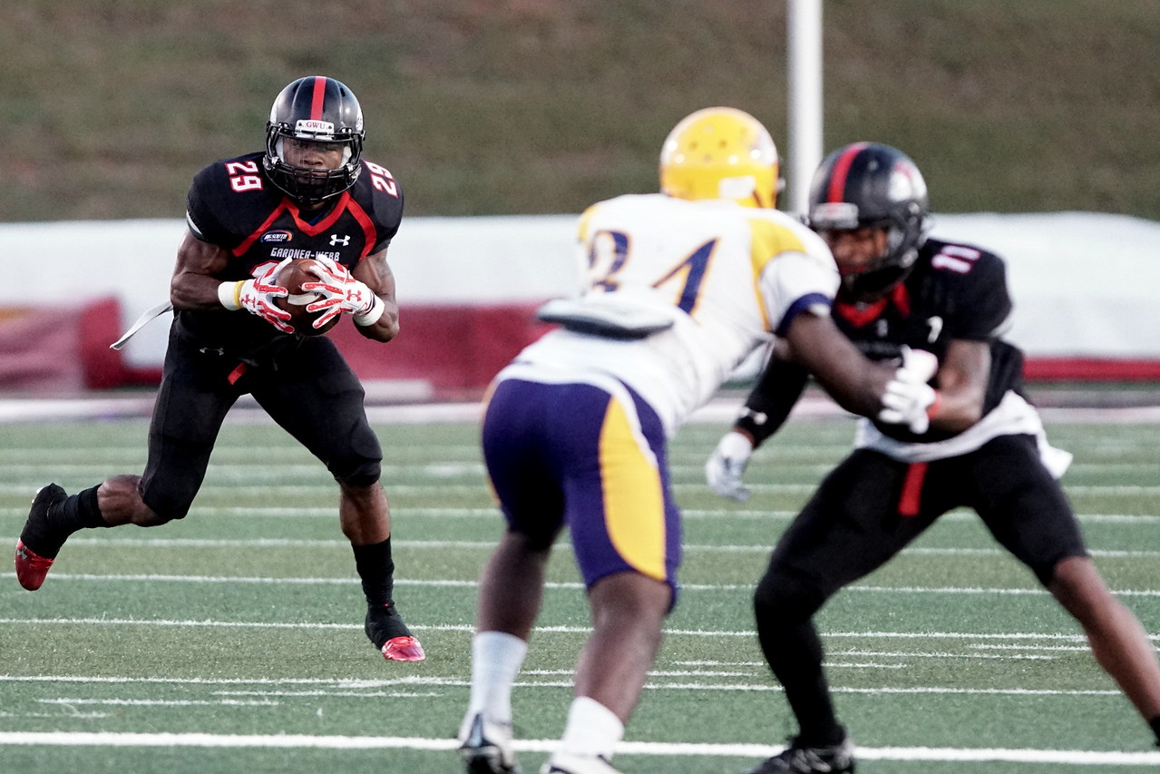 Elijah Perry takes the ball downfield as his teammate A.J. Keene stops a Benedict player. -Taken by Ashley Falls
