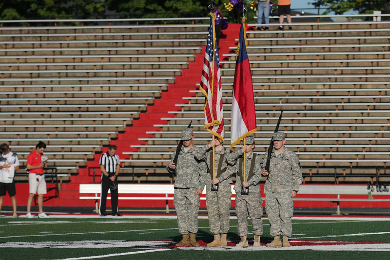 ROTC holds flags while the national anthem plays before kickoff.