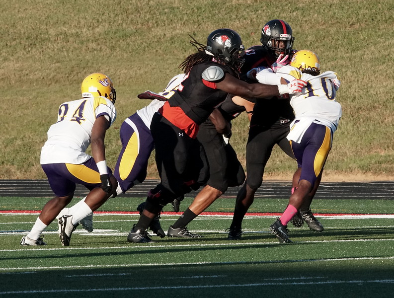 Mike Estes is tackled by Benedict. -Ashley Falls