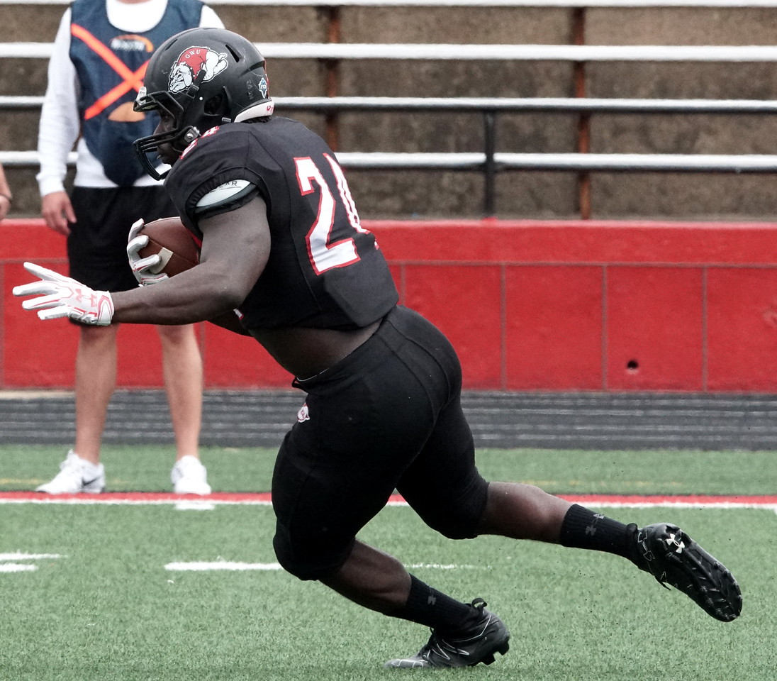 Khalil Lewis runs with the ball