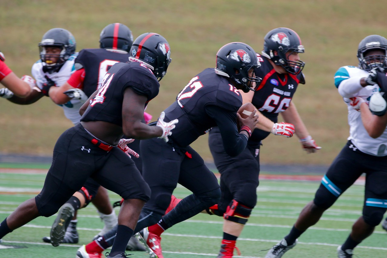 Quarterback, #12, Tyrell Maxwell, escapes with the ball.