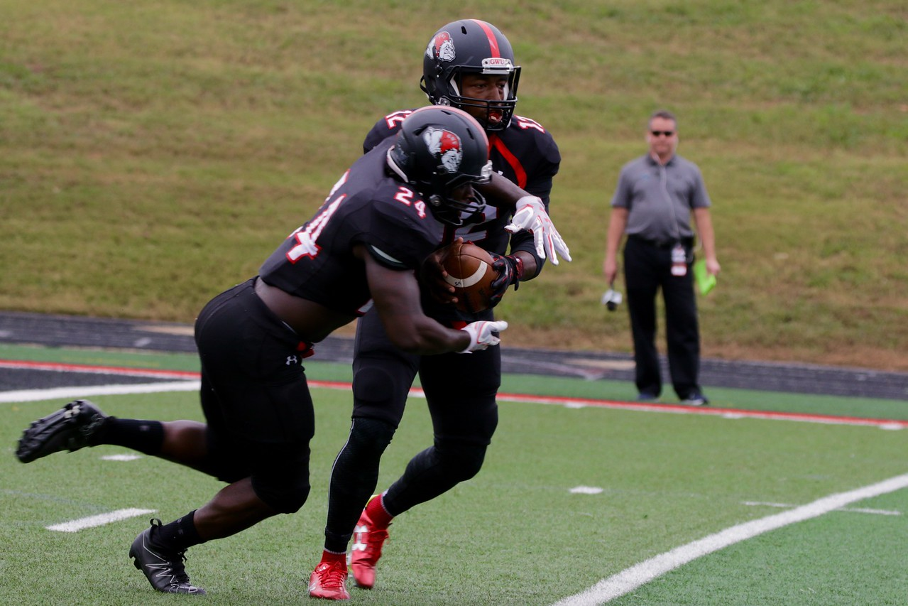 Quarterback, Tyrell Maxwell, attempts to pass the ball to #24, Khalil Lewis.