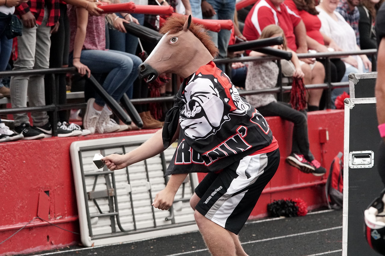 A student dances during the game.