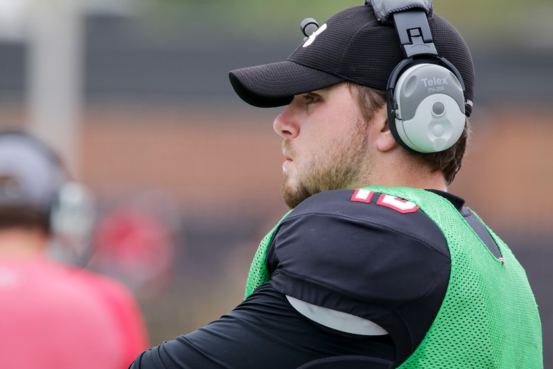 Chase Arrington watches and gives commands from the sidelines.