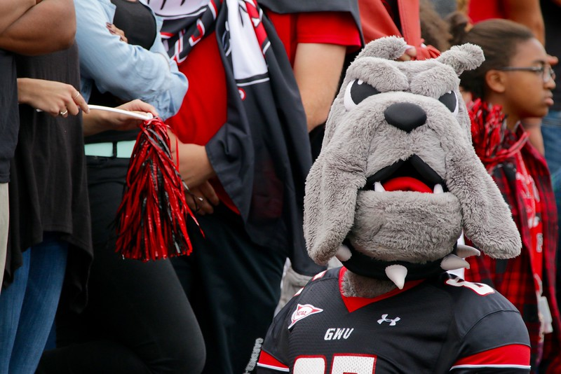 Mac the Bulldog interacts with the student section during the game.