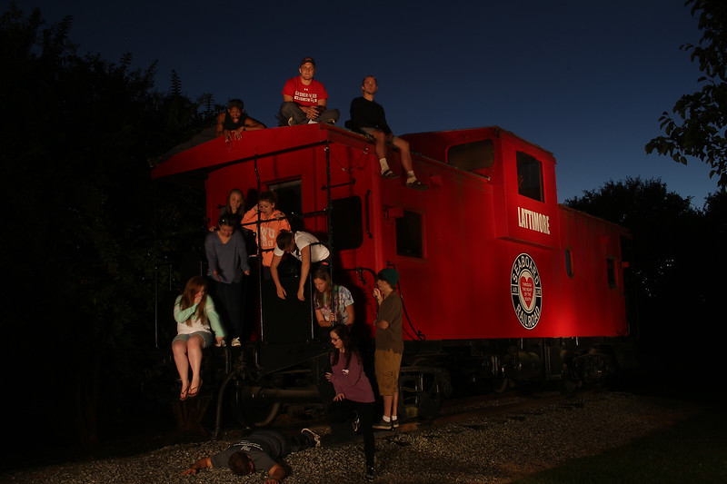 Dr. Bob Carey's photo class after they lightpainted the Lattimore Caboose