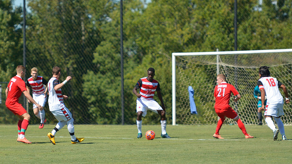David Koloko, number 26, helps move the ball down the field.