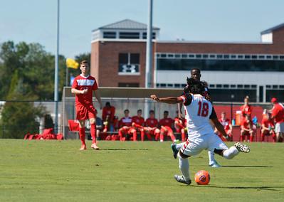 Alain Delgado, number 18, passing the ball.