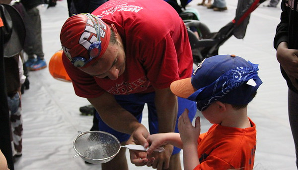 Freshman, Dowdy Sarvis, teaching him how to fish for ducks