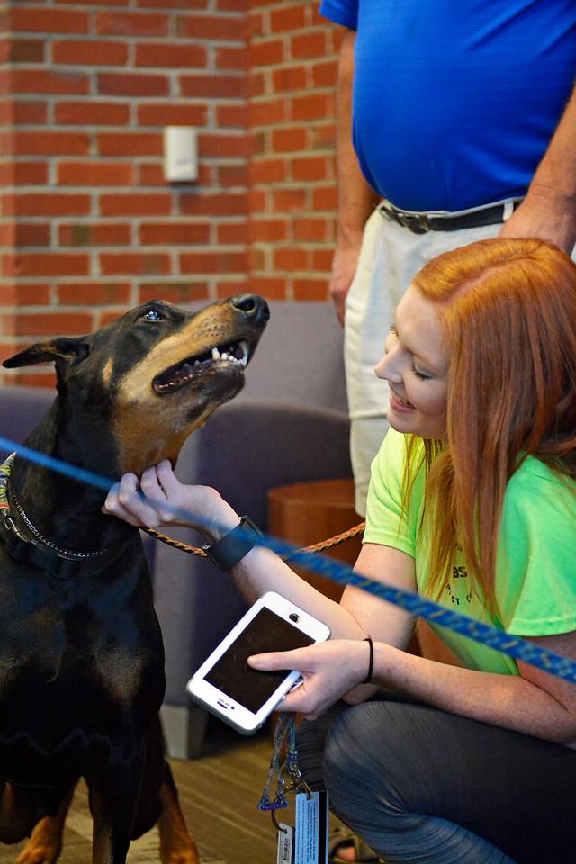 Student, Jodi Blanton petting one of the dogs