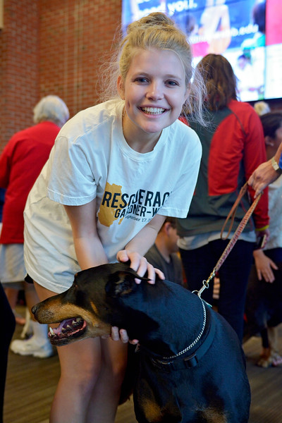 Student, Grace Lodholz playing with one of the dogs