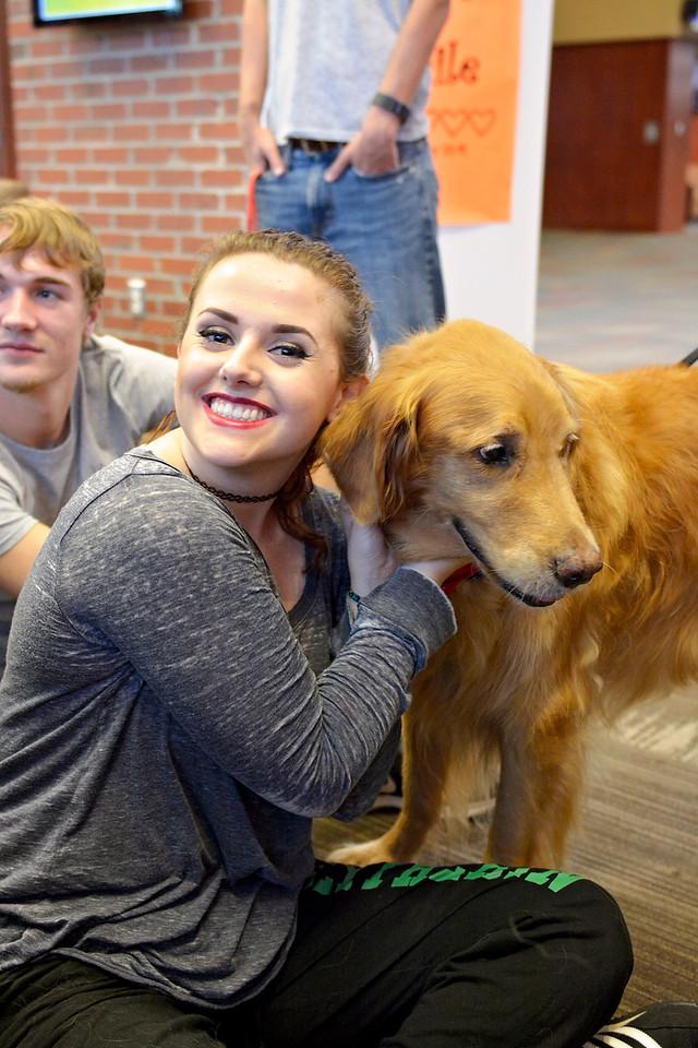 Savannah Stringer petting Finley