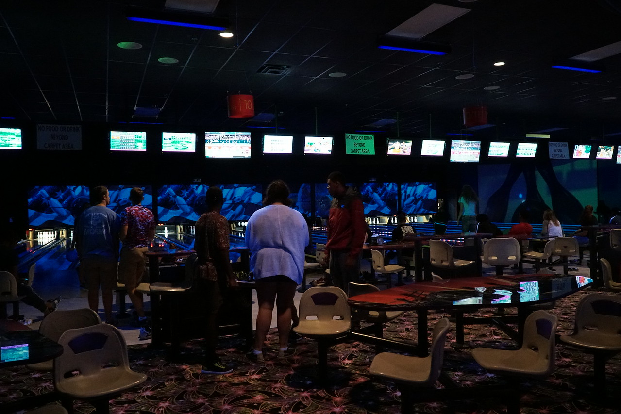 Students wait for their turn to bowl.