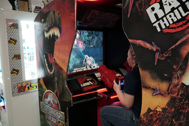 A student plays one of the many shooting games at the arcade.
