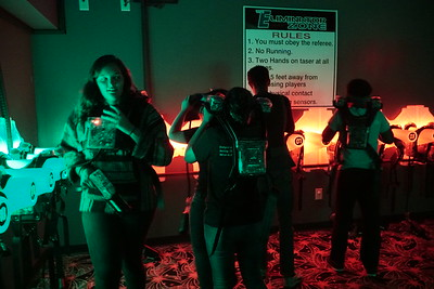 A group of students suit up for laser tag.