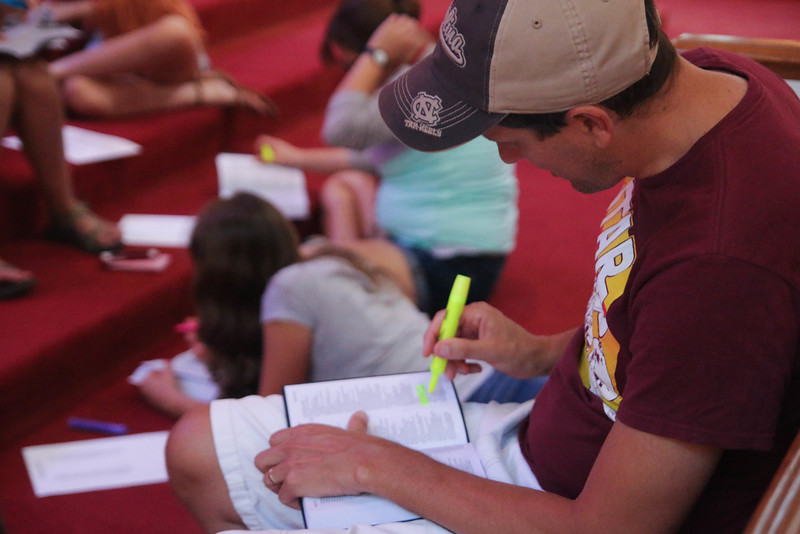In order to live out what they learned at the CMU Fall Retreat, students and faculty spent about an hour serving the First Responders of Cleveland County by highlighting specific encouraging verses and passages in 100 Bibles to give them when they go out on calls. Here CMU Associate Pastor, Neal Payne, highlights his Bible.