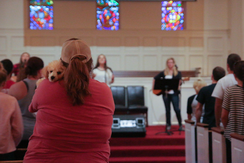 GWU Senior and FOCUS Leader, Megan Dellinger, holds service dog during the worship service on Friday night at the CMU retreat.