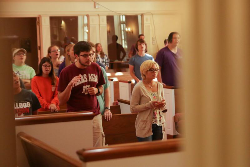GWU Junior and FOCUS Leader, Justin Howard, worships on Saturday morning at the CMU retreat.