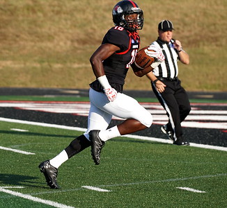 Jonathan Blackmon runs to score a touchdown against Citadel.