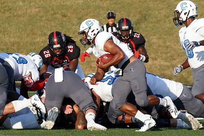 A Citadel player attempts to plow through a pile-up.