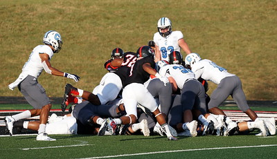 The players tackle each other.