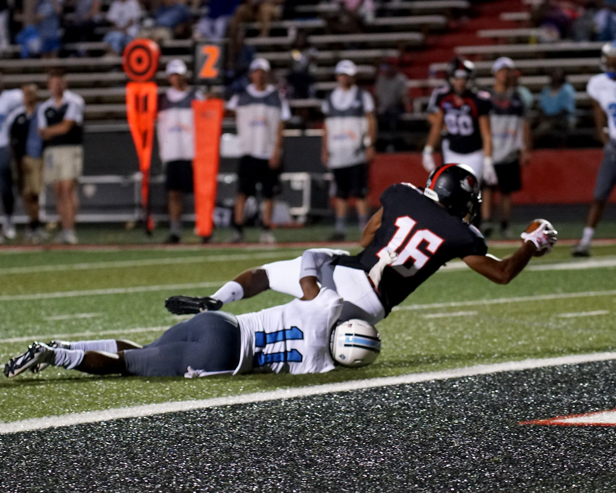 Willie Jackson IV diving into the end zone after the tackle.