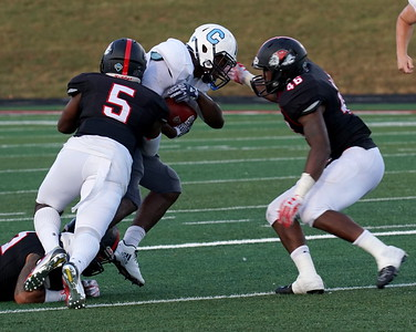 Number 5, Trey Lucas, tackles a Citadel player.