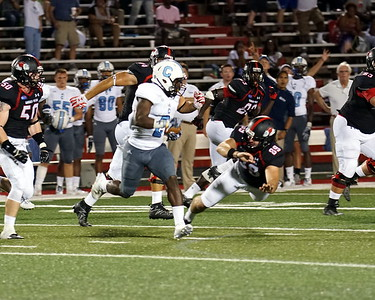 Andrew Komornik jumps after a Citadel player.