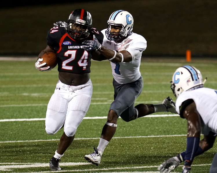 Khalil Lewis, number 24, runs from the attack of a Citadel player.
