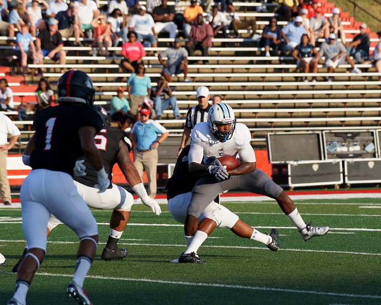 A Gardner-Webb player takes down a Citadel player.