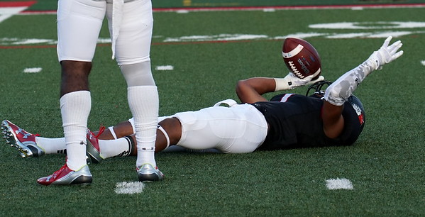Triston Dozier lays on the ground after a play.