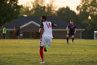 Marin Mendy, #14, looks for the pass, while wearing a blue stripe to support the loss of Shelby Policeman Tim Brackeen. Gardner Webb v. Furman 9/13/16