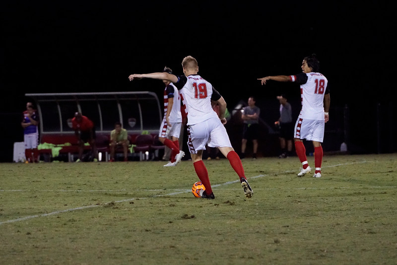 Simen Olsen, #19, kicks the ball up the field, to defend the Gardner Webb goal.  Gardner Webb v. Furman 9/13/16