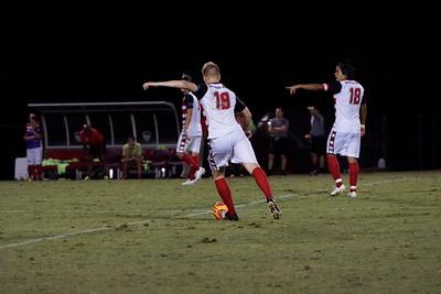 Simen Olsen, #19, kicks the ball up the field, to defend the Gardner Webb goal.  Gardner Webb v. Furman 9/13/16